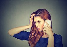 Stressed girl speaking on phone royalty free stock photography