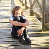 Stressed girl on wooden bridge Royalty Free Stock Photos