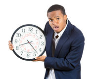 Stressed guy running out of time Royalty Free Stock Photography