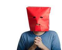 Stressed guy wears red paper bag Stock Photo