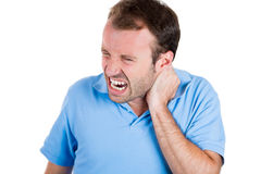Really stressed handsome man with really bad neck pain Royalty Free Stock Image