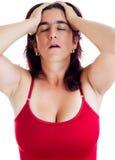 Stressed hispanic woman with a headache Stock Photo