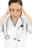 Stressed hospital worker. Stressed nurse or doctor having a headache,  on white background Stock Photography