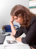 A stressed and ill businesswoman Stock Image