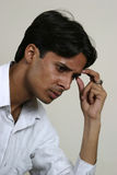 Stressed indian. Portrait of a young indian looking stressed, sad and serious Royalty Free Stock Image