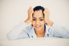 Stressed Indian business woman headache depressed Royalty Free Stock Photos