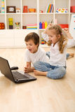Stressed kids about to win online game Royalty Free Stock Photography