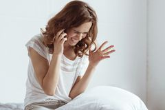 Stressed lady gesturing while talking on phone. Hate my life. Completely emotionally exhausted woman gesturing and getting angry while having a phone Royalty Free Stock Images