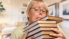 Stressed Librarian, Student or Businesswoman Juggling Books Royalty Free Stock Photo