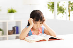 Stressed little girl study  in living room Royalty Free Stock Photos