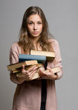 Stressed looking young student woman. Royalty Free Stock Images