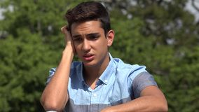 Stressed Male Hispanic Teenager. A handsome hispanic male teen stock video footage