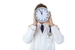 Stressed male medical doctor under time pressure Royalty Free Stock Image