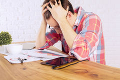 Stressed male over desk Royalty Free Stock Images