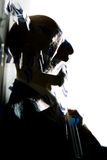 Stressed man. An abstract silhouetted profile of a man under extreme stress stock photography
