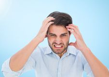 Stressed man against blue background Royalty Free Stock Photography