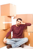 Stressed Man Between Boxes Royalty Free Stock Photos