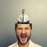 Stressed man and calm businessman