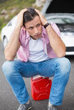 Stressed man after a car breakdown Stock Photography