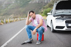 Stressed man after a car breakdown. At the side of the road Royalty Free Stock Photos