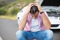 Stressed man after a car breakdown Stock Photo