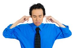 Stressed man covering ears Stock Photo