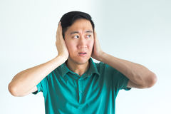 Stressed man covering his ears and do not want to hear, noise too loud. Royalty Free Stock Images