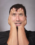 Stressed man covering his face Royalty Free Stock Photo