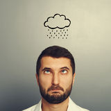 Stressed man with drawing storm cloud Royalty Free Stock Photography