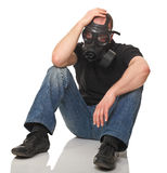Stressed man with gas mask Stock Images