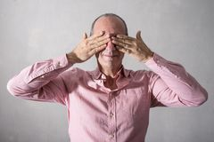 Stressed man with hands in front of eyes. A Stressed man with hands in front of eyes stock photography