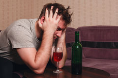 Stressed man after hard drinking. Stock Image