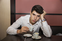 Stressed Man Having a Cup of Coffee at the Table Royalty Free Stock Photos