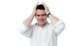 Stressed man having strong headache Royalty Free Stock Images