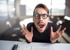 Stressed man hysterical in office Royalty Free Stock Image