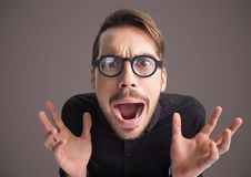 Stressed man hysterical with purple background Royalty Free Stock Image