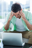 Stressed man with laptop at home Royalty Free Stock Photo