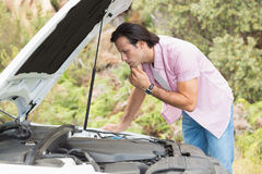 Stressed man looking at engine Stock Image
