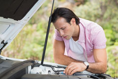 Stressed man looking at engine Stock Images