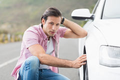 Stressed man looking at wheel Royalty Free Stock Photo