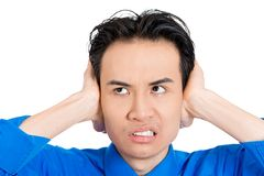 Stressed man by loud noise Stock Photography
