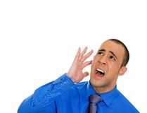 Stressed man by loud noise Royalty Free Stock Image