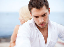 Stressed man with man outside. Dating and relationships concept - stressed men with men outside Stock Image