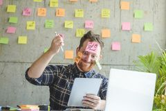 Stressed man with message on sticky notes Royalty Free Stock Image