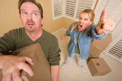 Stressed Man Moving Boxes for Demanding Wife. Surrounded by Other Boxes Stock Image