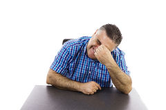 Stressed man at the office Stock Photography