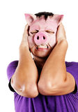 Stressed man with pig mask Stock Photo