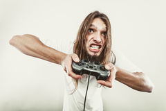 Stressed man playing on pad Stock Photography