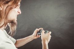 Stressed man playing on pad Stock Photo
