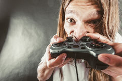 Stressed man playing on pad Stock Images